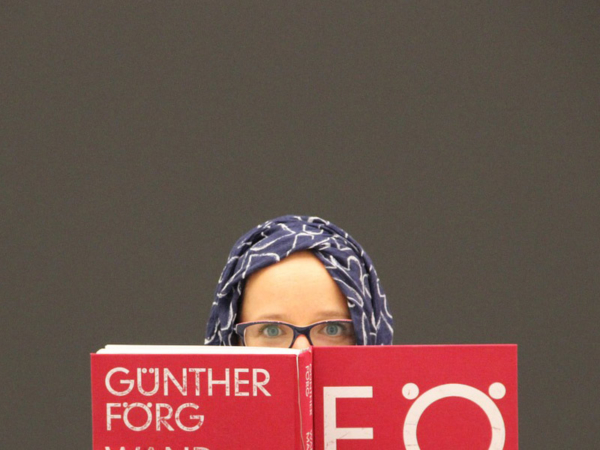 Woman in Hijab Reading